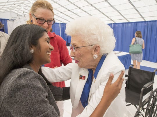 Jerry Emmett, the 102-year-old honorary chair of the Arizona Democratic delegation, meets Sruthi Palaniappan, an 18-year-old Iowa delegate at the Democratic National Convention in Philadelphia on Wednesday, July 27, 2016.