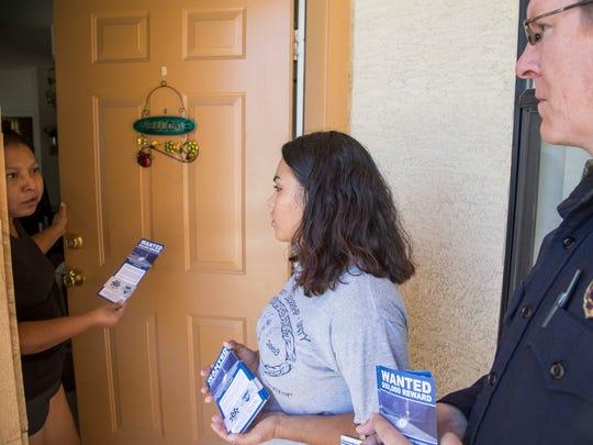 Phoenix Police Community Action Officer Joey Mayfield (right) goes door to door with the help of Center for Neighborhood Leadership Volunteer Norma Jimenez in 2015.