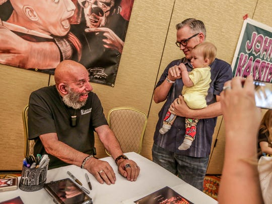 Actor Sid Haig (left) poses for photos with Warren and Amelia Fisher at Days of the Dead in Indianapolis in 2015.