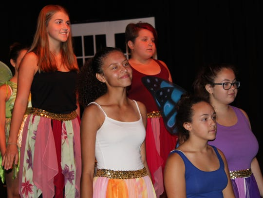 Cast members rehearse a scene from the Cumberland Players'