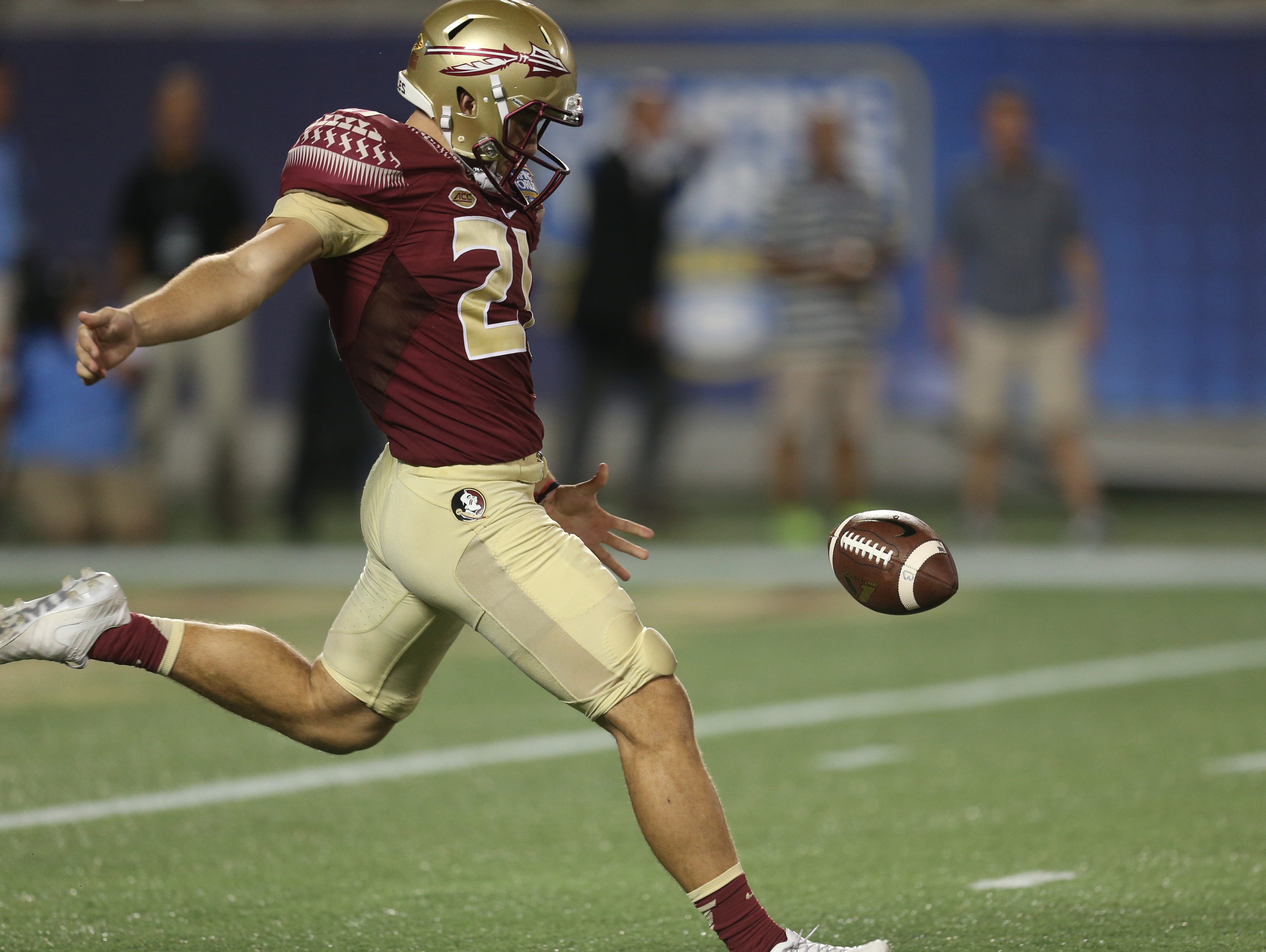 FSU's Logan Tyler punts the ball during a game against Ole Miss at Camping World Stadium on Monday, Sept. 5, 2016.