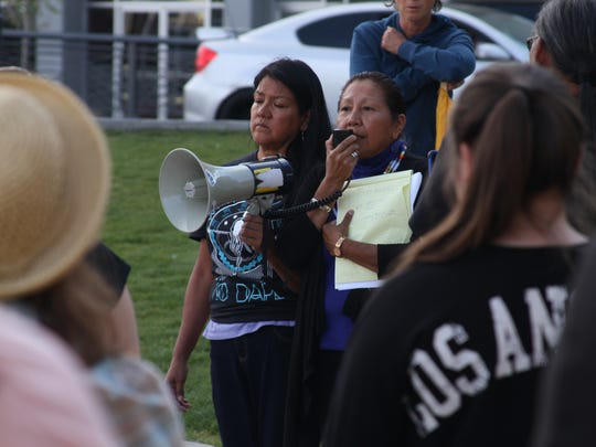 Dr. Debra Harry addresses people protesting against the Dakota Access Pipeline on Tuesday, Sept. 20 at the Reno City Plaza.