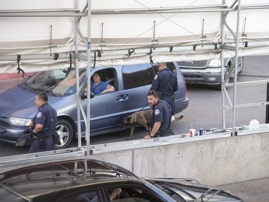 U.S. Customs and Border Protection officers use dogs