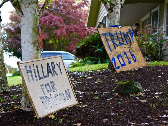 A vandalized Pro-Donald Trump sign sits on the lawn of Salem resident Sonja Davis's  was on Tuesday, Oct. 18.