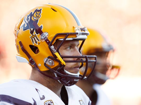 Arizona State quarterback Taylor Kelly wears the Sparky helmet during the game against Arizona on Friday, Nov. 28, 2014 in Tucson, AZ.