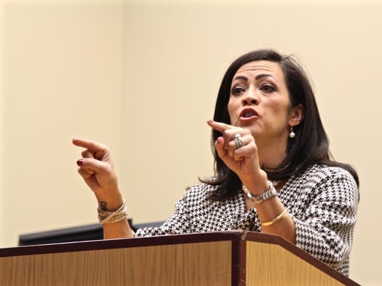 """Laura Morett, candidate for HD 20, explains the story of one Latino member of the community who said she's afraid to make the """"wrong decision"""" in the election at the Political Forum on Latino Issues hosted by the Latino Business Alliance on Wednesday, Oct. 26 at the Chemeketa Center for Business & Industry."""