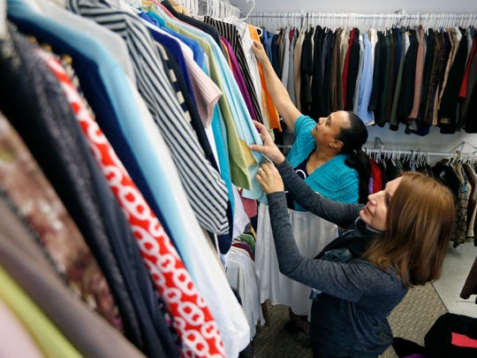 Shopper Gloria Medina of Rochester looks through clothes with volunteer Judy Morabito of Victor at the Angels of Mercy, Inc. boutique. The non-profit organization helps those who were victims of human trafficking or prostitution.