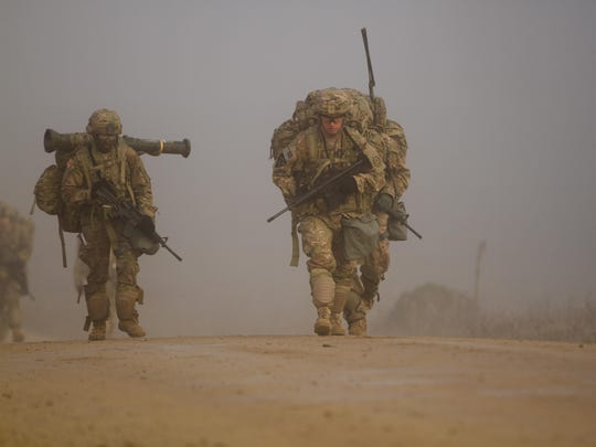 U.S. Army Soldiers, assigned to 2d Cavalry Regiment, conduct a 12-mile ruck march during a unit spur ride near Camp Albertshof, Germany, Dec. 9, 2015.