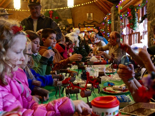 Hayden Latkiewicz, left, helps create a reindeer out of bark, twigs and pipe cleaners at the 39th Annual Silver Falls State Park Christmas Festival on Saturday, Dec. 10.