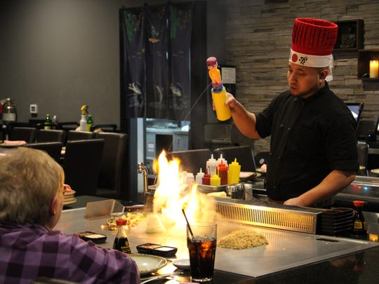 A Nagoya chef extinguishes his flaming onions with a water squeeze bottle.