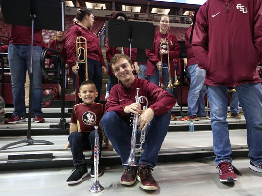 DJ Read, 4, poses with Adam Frazier of the Seminole Sound during the women's basketball game against Wake Forest at the Tucker Civic Center on Thursday, Feb. 9, 2017.