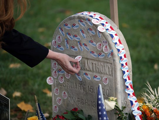 "Voters lined up on Election Day 2016 to place ""I voted"" stickers on the grave of Susan B. Anthony at Mt. Hope Cemetery. Max Schulte /Rochester Democrat and Chronicle file photo"