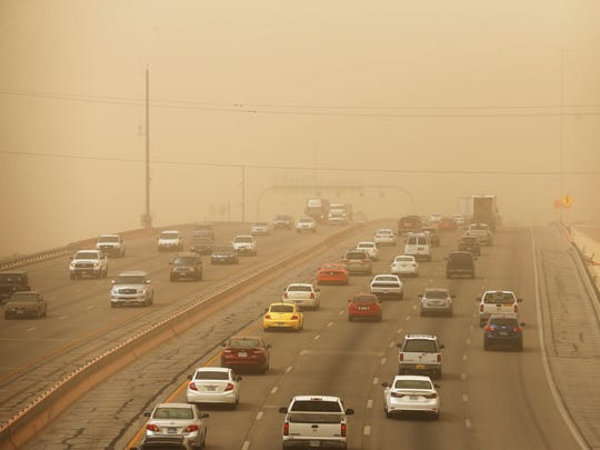 Visibility was down to less than a half mile as wind blew into the Borderland in this file photo taken from Spur 66 looking west onto Interstate 10 near the University of Texas at El Paso.