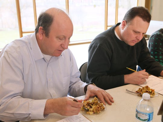 Judges Larry Glusman (left) and Andy Tarnoff sample an entry in the competition.