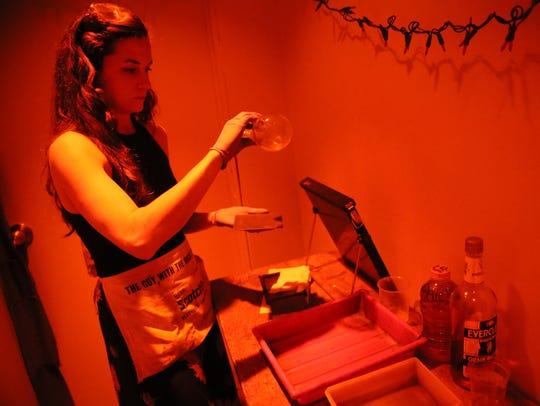 Margaret Muza starts the process of treating the tintype