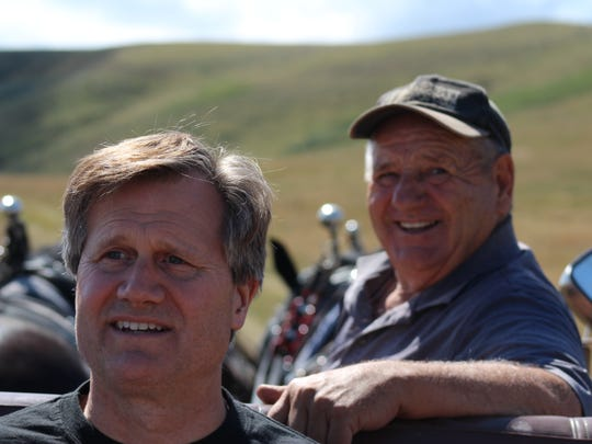 Author B.C. Nelson (left) and buddy Dee Olsen scan the countryside.