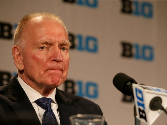 Michigan hockey coach Red Berenson listens to questions