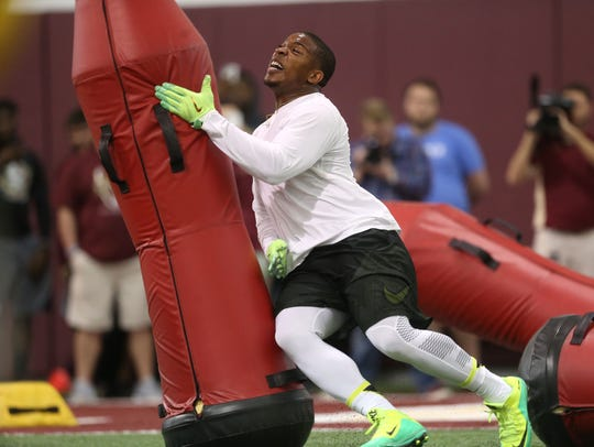 DeMarcus Walker performs for NFL personal during FSU's