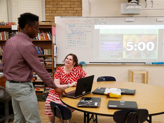 English teacher Stephanie Fowler listens as a student practices his presentation on Wednesday, May 17, 2017, inside the Flex Academy classroom at Roosevelt High School in Des Moines.