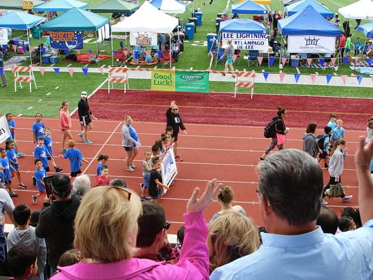 Parents wave at more than 3,000 first through fifth graders participating in the 43rd Annual Country Financial Kids Relays at the Willamette University McCulloch Stadium on Saturday, May 20, 2017.