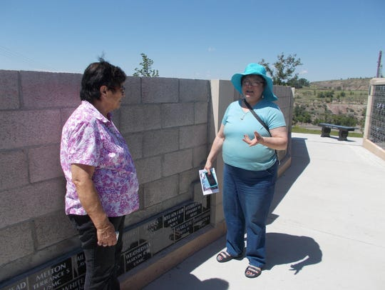 Shirley Boyle-Gobert, left, stands by the plaque for