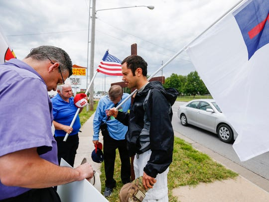 From left, Dennis Vance, Bob Mondy, Allen Kemper and Aaron Brummitt bow their heads in prayer before protesting in front of Planned Parenthood in 2017.