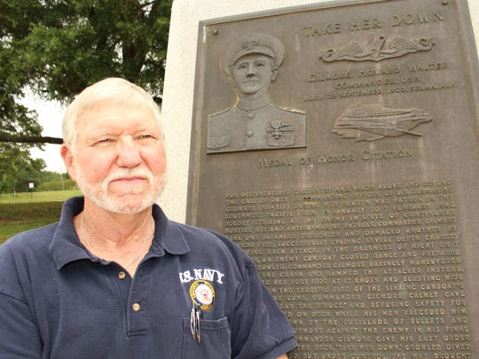 Decorated Vietnam veteran Rod Stone stands next to the monument praising Medal of Honor recipient Howard in Selma.