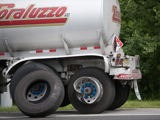 The rear left wheel and back end of a tanker truck is damaged after a collision with an automobile near the intersection of Red Lion Road and U.S. 13 Thursday.