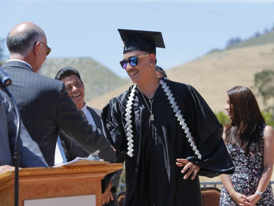 Jacob Duran smiles as he graduates from the Rancho