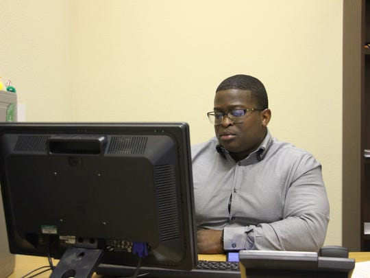 Outreach Specialist Cedric Sanders works on his computer Friday, June 16, 2017, at Coastal Compass.