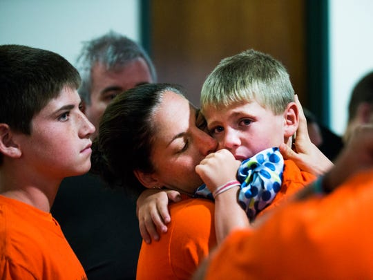 "Jessica Riner, center, kisses her youngest son, Braden, 5, after hearing the verdict for Rene Miles at the Collier County Courthouse on Tuesday, June 20, 2017. Miles was found guilty of his felony DUI manslaughter charge and one count of DUI causing serious bodily injury for the crash that seriously injured Jessica and killed her husband, James ""Cecil"" Riner, in December 2015."