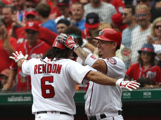 The Nationals' Anthony Rendon celebrates his third-inning home run with Jose Lobaton on Thursday.