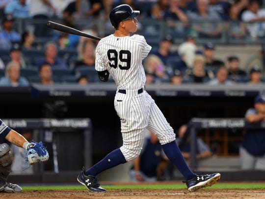 Yankees right fielder Aaron Judge (99) follows through on a solo home run against the Tampa Bay Rays during the fourth inning at Yankee Stadium on Friday, July 28, 2017.