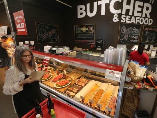 Amy Jerman gets fresh meat from the butcher counter.