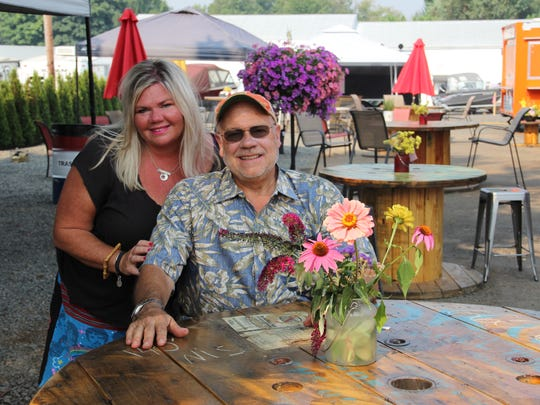 Kelly Morales and Stanley E. Rogers sit within Beehive Station, their South Salem food truck pod