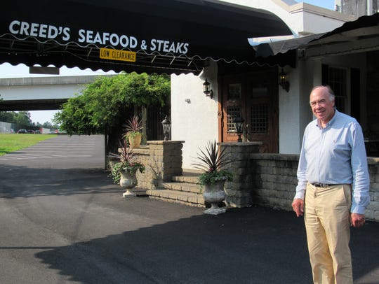 Jim Creed stands in front of his restaurant, Creed's