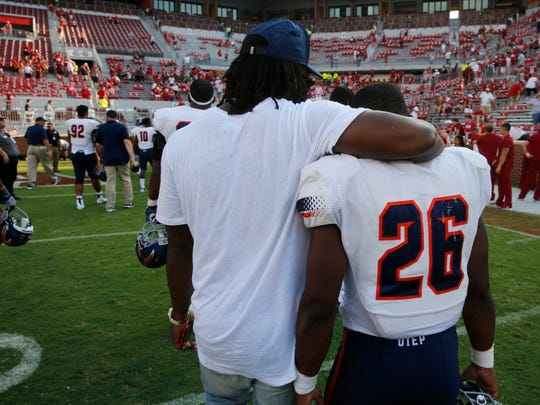 Former UTEP running back Aaron Jones walks out of the Gaylord Family-Oklahoma Memorial Stadium with running back Walter Dawn Jr., after the Miners lost their season opener to the Sooners 56-7.