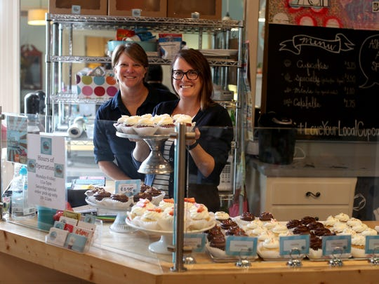 Lucy & Leo's Co-owners Jean Bates (left) and Paula Lucas pose in the cupcakery's storefront on Thomasville Road Thursday. After 8 years in operation, they are looking for the right person to buy the business.