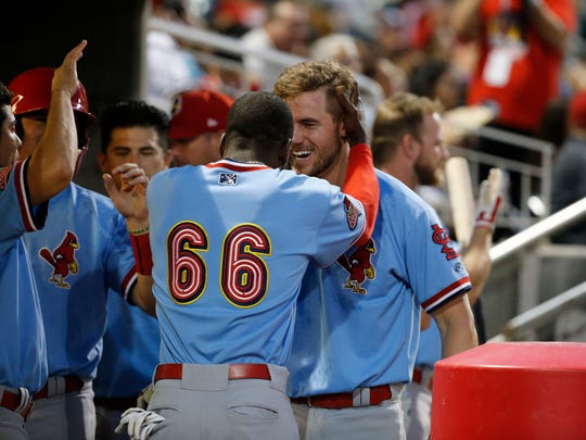 Redbrids first baseman Patrick Wisdom gets greeted by teammate Adolis Garcia, after hitting a two-run home run during the fifth inning of action Sunday night in Southwest University Park.