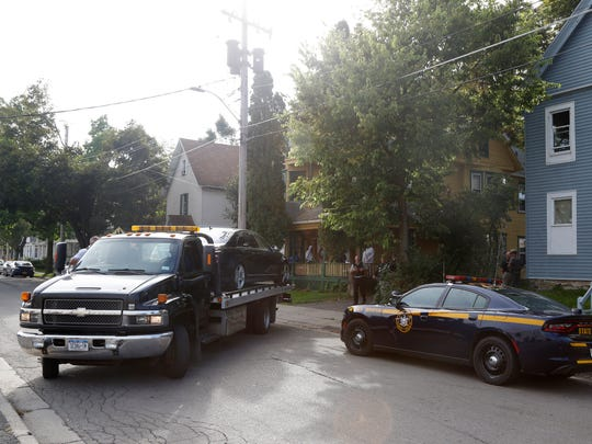 Police conduct a raid early Wednesday at 4 Ogden St.