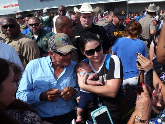 George Strait takes pictures and signs autographs in Rockport, TX on Thursday, September 21, 2017. He and Texas Governor Greg Abbott were in town to visit with individuals affected by Hurricane Harvey.