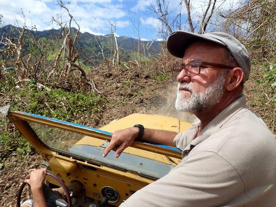 Coffee-farm owner José Roig surveys damage to his farm