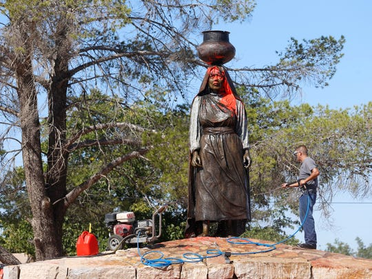 "Members of the Ysleta Del Sur Pueblo were hurting Monday and wondering why the statue of Nestora Granillo Piarote was vandalized with red paint and a cross with ""Columbus Day"" written on it. The statue was cleaned and the investigation continues."