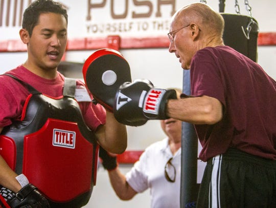 The Rock Steady Boxing class holds a session at Snap