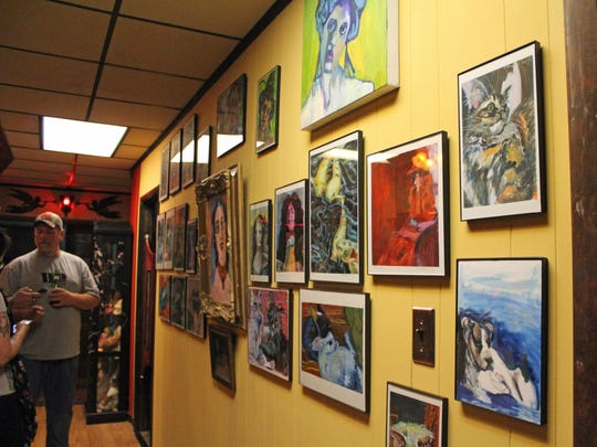 Some of Rone Del Galeone's artwork that is on display at Moerder Tattoos and Gallery.