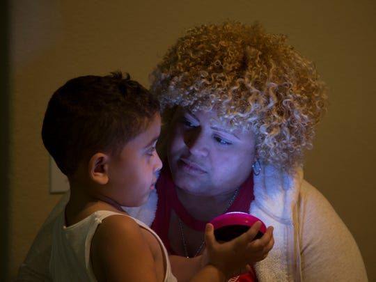 Grace Castro, 36, talks with her 4-year-old son, Yetzael,