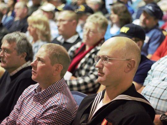 Veterans listen to the River Valley High School chorus,