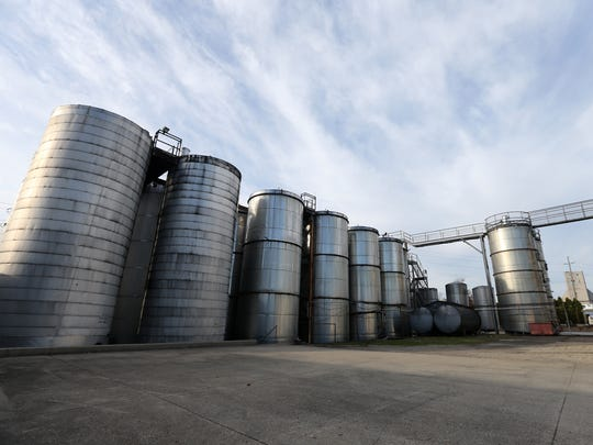 Stainless steel storage tanks tower on the property,
