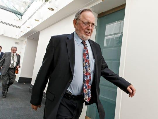 Rep. Don Young, R-Alaska, leaves a closed-door Republican