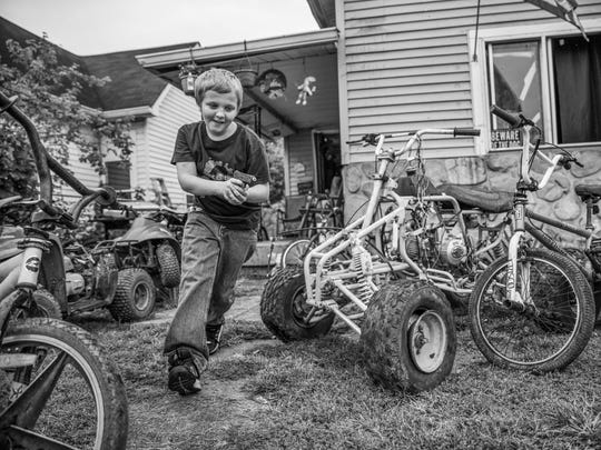 """Pow, pow, pow, pow,"" said James Smith, 11, as he plays near an old four-wheeler frame missing its engine. ""You're dead."" Smith and his younger brother, Clinton, 6, took turns being the bad guy while playing jail on a dreary afternoon in Near West on Tuesday, Sept. 12, 2017."
